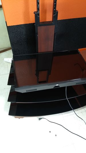 It's a TCL 65 inch flat screen TV with the TV stand I'm asking for 450obo for Sale in Terre Haute, IN