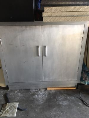 Silver TV stand / cabinet for Sale in Tampa, FL