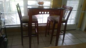 Tall Kitchen table 2 chairs solid wood. Table has glass on top. for Sale in Hendersonville, TN