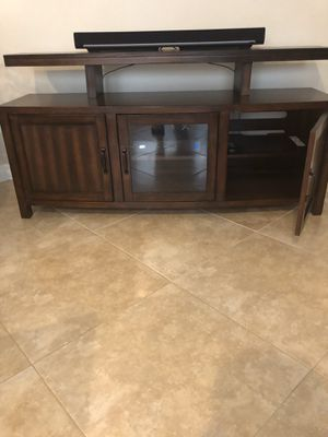 """Entertainment Console made by Weston. It is 60"""", in great condition. The Sonar Bar is not included. for Sale in Riviera Beach, FL"""