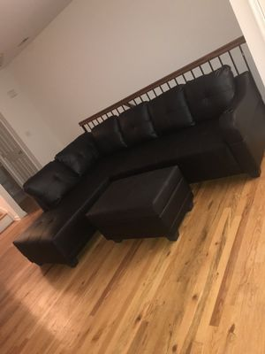 Black pleather sectional with storage ottoman for Sale in Toms River, NJ