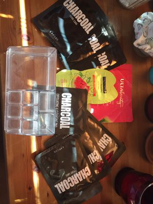 Charcoal and watermelon facial mask w/ makeup organizer for Sale in Queen Creek, AZ