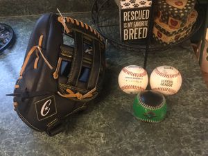 "Brand new left handed 12"" baseball or softball glove. Comes with either 3 baseballs or 3 softballs. for Sale in Plainfield, IL"