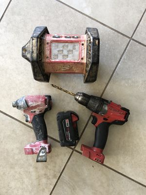 Milwaukee Fuel Impact Driver Drill and Light with battery for Sale in Oceanside, CA