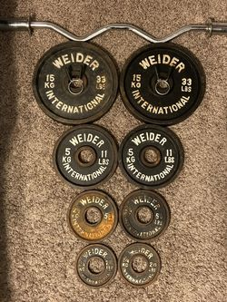 Curl Bar (42 Inches) And Weider International Weight Set (2) 33Lbs, (2) 11Lbs, (2) 5.5 Lbs, (2) 2.75Lbs $160.00 OBO for Sale in Rancho Cucamonga,  CA