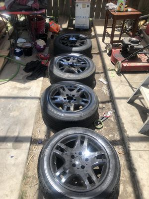"""Black 16"""" Mercedes rims and tires asking 250$ good tread on 3/4 tires open trades for Sale in Selma, CA"""