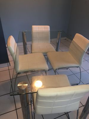 Modern Dining Room table and 4 white leather chairs City Furniture for Sale in West Palm Beach, FL