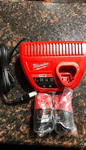 Milwaukee m12 batteries and charger brand new like dewalt makita rigid m18 works with saws,flash light,impact ,drills for Sale in Riverside, IL