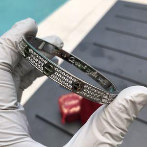 Cartier love bracelet 3 line stones for Sale in Miami, FL