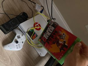 Xbox One with 1 controller and charging station and red dead redemption for Sale in Pembroke Pines, FL