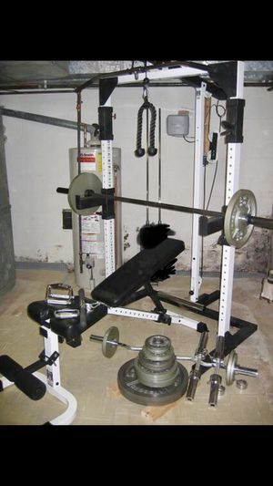 Tuff stuff squat rack weight bench with 300lbs and accessories for Sale in Saint Charles, MO
