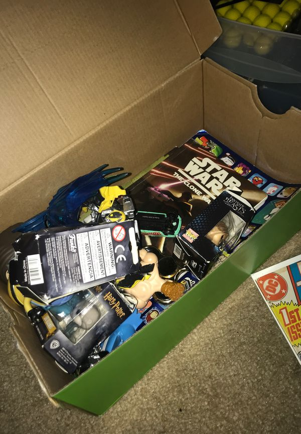 Box of toys and comics and Pokémon cards and pop figures and mini pop figures