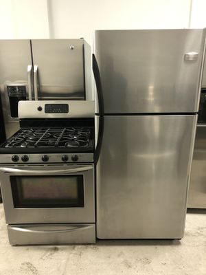 Frigidaire top and bottom stainless steel refrigerator & Frigidaire 5 burner stainless steel gas stove set for Sale in Chicago, IL