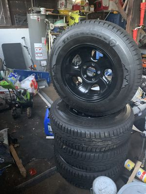Chevy gmc rims black powder coating and snow tires for Sale in New Britain, CT