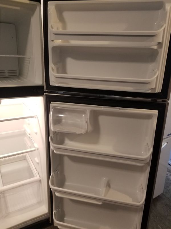 Frigidaire Stainless Steel Top freezer refrigerator very clean works great fully functional