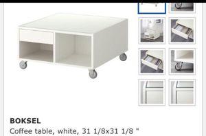IKEA Boksel glass coffee table white metal wheels for Sale in NJ, US
