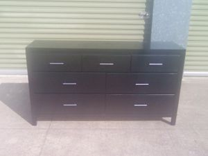 Gloss black Dresser in good condition drawers fuction well it's wood with slot of life for Sale in Austin, TX