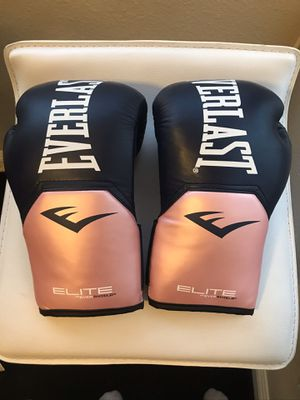 Brand new women's 12 oz elite Everlast boxing gloves for Sale in Las Vegas, NV