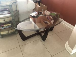 Glass table with dark brown legs for Sale in Miami, FL