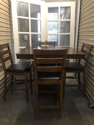 Heavy pub dining room table and 4 bar stool chairs with storage for Sale in Lodi, CA
