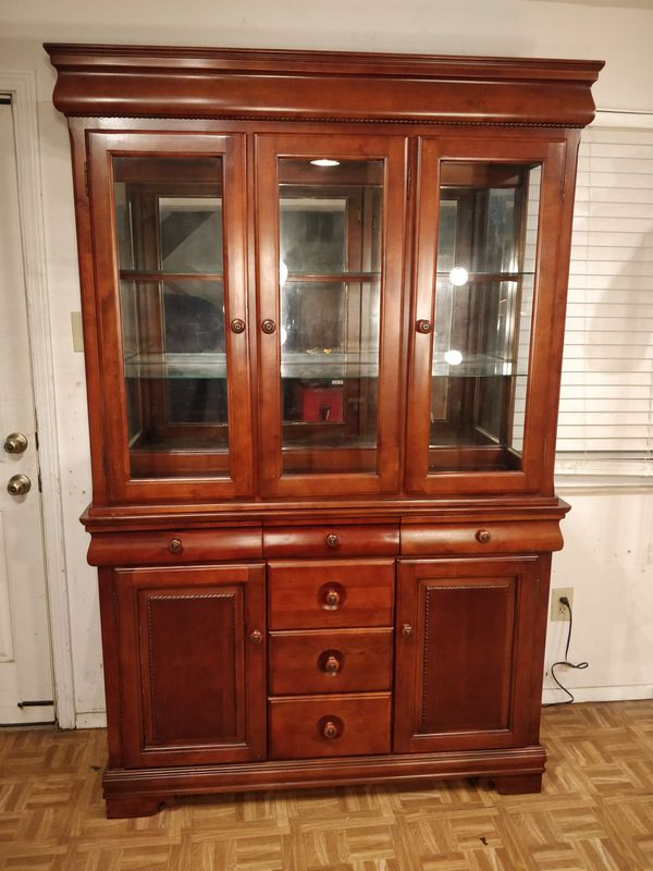 Solid wood 2 pieces China cabinet/TV stand/buffet with drawers, shelves & light in great condition, all drawers working well dovetail drawer