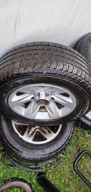 03 nissan pathfinder rims good tires for Sale in Pennsauken Township, NJ