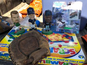 Baseball glove from the 1940s can Griffey Junior bobble head Roger Clemens bobble head and Mark Maguire and Ken Griffey Junior's mom starting lineup for Sale in East Windsor, NJ