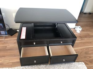 Black coffee table raise up tray to eat at storage for Sale in Herndon, VA