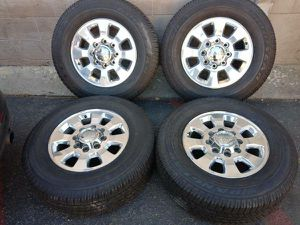 Four 18 inch GMC rims and tires 8 on 180mm for Sale in Montebello, CA