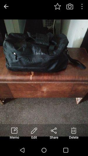 Calvin kline rolling duffle bag for Sale in Clovis, CA