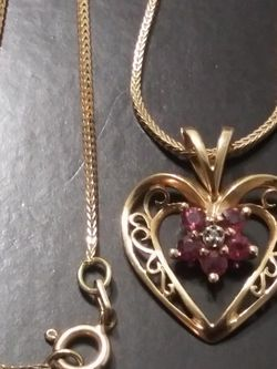 PURE 14K CHAIN WITH A BEAUTIFUL NECKLACE HEART SIZE 18 LONG NEED TO GO FAST. for Sale in Manassas,  VA