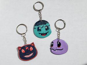 Halloween pokemon keychains. Monster Bulbasaur, Frankenstein Charmander, Vampire Squirtle for Sale in West Jordan, UT