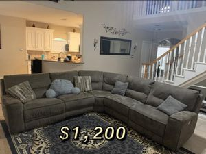 Sectional couches with electric end seats that recline. And tv stand for sale.. for Sale in Rosharon, TX