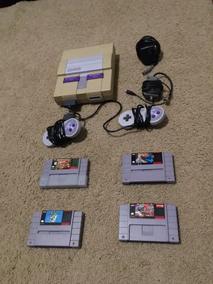 Super Nintendo 2 controllers and 4 games for Sale in Raleigh, NC