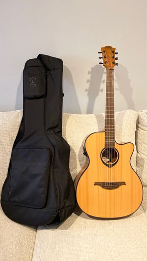 Lag Acoustic Electric guitar with Levy's soft cushioned gig bag for Sale in Philadelphia, PA