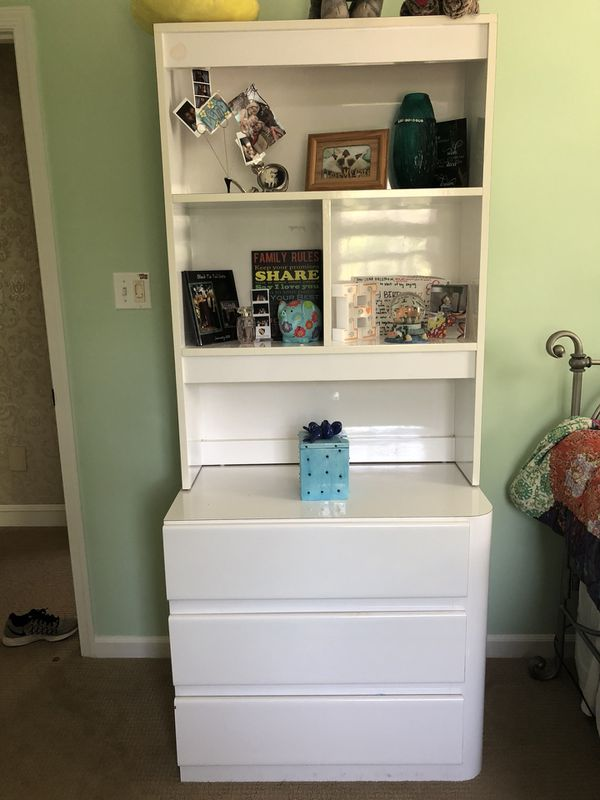 White bookcase with drawers; two nightstand/dressers