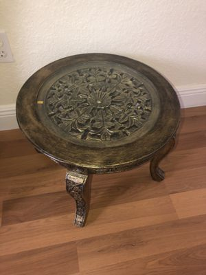 "Carved wooden accent table with glass top in an excellent condition for $40 ( measures 19"" in diameter and 15"" in height) for Sale in Southwest Ranches, FL"