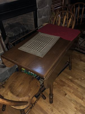 Wood kitchen table with fold out sides and 4 chairs for Sale in Cottageville, WV
