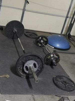 Olympic bar & easy curl bar with plates for Sale in Henderson, NV