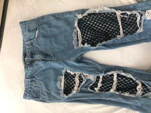 Distressed jeans with fishnet stockings for Sale in Taunton, MA