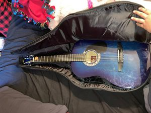 Guitar. Comes with pic, 2 learner books & guitar case for Sale in Altadena, CA