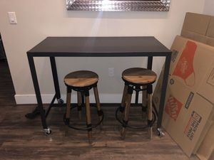 Black industrial style bar top table with two adjustable stools for Sale in Denver, CO