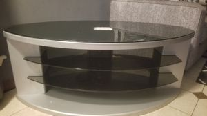 Tv stand grey with dark colored glass tiers. Like new 50.00 takes it. Located in del valle. for Sale in Austin, TX