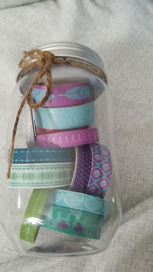 Washi tape 13 different rolls...all NEW... glitter, arrows, feathers, elephants, geometric patterns, green, teal, purple, silver and red for Sale in Fontana, CA