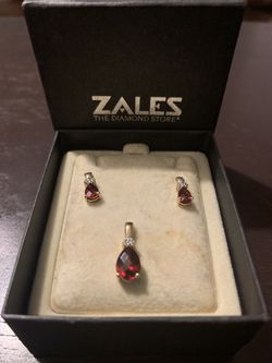 Zales Pear-Shaped Garnet (January Birthstone) and Diamond Accent Drop Pendant/Earrings(Gift Set) in 10K Gold for Sale in Murfreesboro,  TN