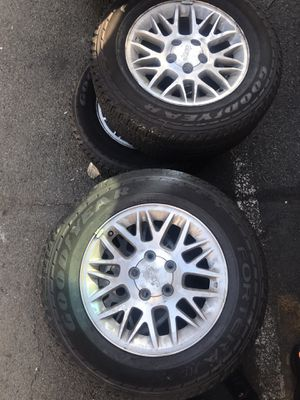 Jeep oem wheels with good tires. for Sale in Prospect Park, NJ