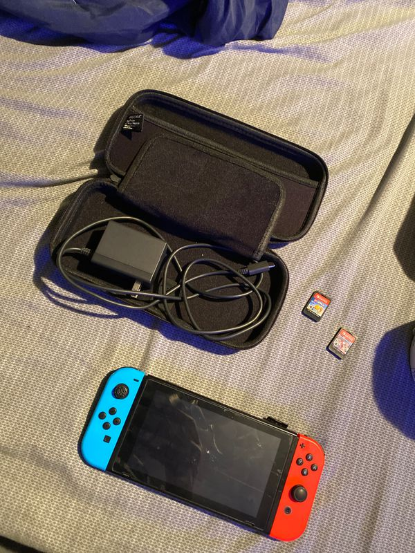 Nintendo switch with 2 games and charger and case and screen protector 250
