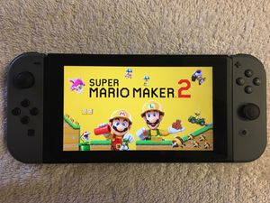 NINTENDO SWITCH + 25 Popular Games LUIGIS MANSION 3 , Mario Maker, MARIO KART and More for Sale in San Diego, CA