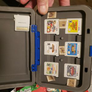 NINTENDO 3DS GAMES and Holding Box For 6 Games. However I Have 7 Games. Barely Used for Sale in Phoenix, AZ