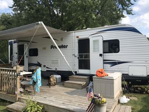 2011 28' prowler by heartland beautiful camper with all the bells and whistles currently on beautiful lake kegonsa with leasing options available or for Sale in McFarland, WI